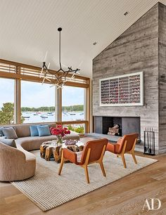 Cozy seating surrounds a teak-root cocktail table in the living room of a breezy Woods Hole, Massachusetts, retreat