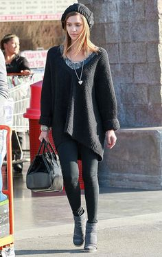 Jessica Alba. Maxi black sweater, poncho, black pants leggings, gray boots, black bag. Winter outfit