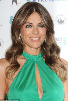 'I am a little bit heavier than back then': Liz Hurley discusses THAT leather catsuit as she dazzles in slinky emerald keyhole gown at Meerkat launch party Elizabeth Hurley Bikini, Heaviest Woman, Elizabeth Jane, Leather Catsuit, Elisabeth, Glamour, Models, Celebrity Hairstyles, Pretty Woman