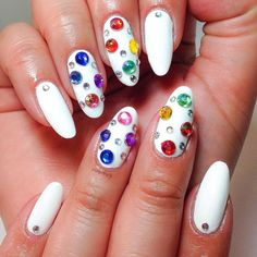 white manicure with rhinestones