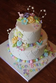 What a sweet cake with rolled fondant roses! @Sam Jones are you up for a tiered cake yet?