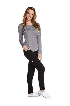 The Women's Long Sleeve Antimicrobial Under Scrub Top is a lightweight undershirt with a streamlined silhouette. Constructed of super soft polyester, this top o