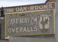 The Oak Rooms/Can'tBust 'Em Overalls ghost signs, Lemoore, California