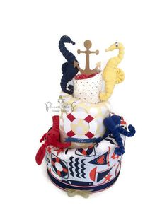 Nautical Diaper Cake. Nautical Baby Shower. Centerpiece. Under the sea. Baby Boy. decoration. Topsy Turvy Diaper Cake. Seahorse. Octopus by PrincessAndThePbaby on Etsy https://www.etsy.com/listing/228390115/nautical-diaper-cake-nautical-baby