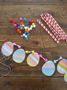 make egg garland with washi tape, straws and pom-poms