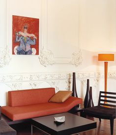 Burnt orange sofa by Eva Pest, PPPP Designs, Lima. Love the detail on the walls!