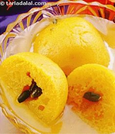Saffron flavoured rasgullas stuffed with dry fruits. Another popular variation of the rasgullas.