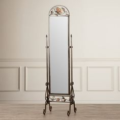 Butterfly Mirror from Wayfair This freestanding Cheval Mirror features gently curved antique bronze metal with butterfly and leaf details. Butterfly wings and leaf panels are a stained glass look.