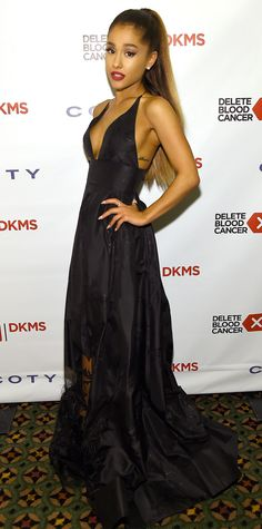 For her performance at the 10th Annual Delete Blood Cancer DKMS Gala, Ariana Grande selected a sweeping black deep-V Yanina Couture gown with metallic floral detailing and a sheer hem.