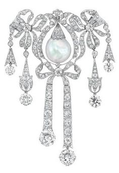 Belle Epoque Diamond and Natural Pearl Pendant-Brooch. Platinum, the openwork brooch of stylised bow and ribbon motif supporting one natural pearl approximately 15.0 x 14.3 x 14.18 mm., the two centre graduating ribbons tipped by 2 old European-cut diamonds approximately 4.00 cts., flanked by four fancy-shaped pierced pendants accented by 4 old European-cut diamonds, set throughout with 121 old European-cut diamonds, circa 1905. #BelleÉpoque #brooch