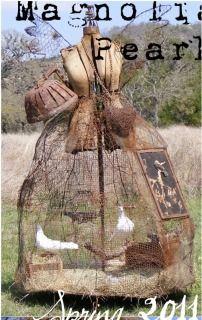 This is so fun, I think it is a dove cage on a dress form.