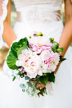 dalia and peony bouquet http://www.weddingchicks.com/2013/09/30/vintage-vineyard-wedding/