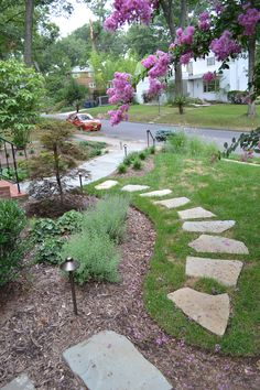 Stone walkway by The Greener Side Lawn and Landscaping LLC.
