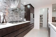 The luxurious Rochester has an abundance of rooms for family fun and entertaining. Visit: www.mimosahomes.com.au Call: 1300 MIMOSA Cupboard Storage, Lighted Bathroom Mirror, Home, Home And Family, Modern Family, Modern, Built In Wardrobe, Bathroom Mirror, Home Decor