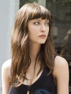 Pretty, simple hair. Thick bangs, kinda messy. Got a little wave. Great face for bangs though. - Fashion Darling