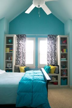 Accent Wall painted SW 6486 – Reflecting Pool. Other walls and ceiling painted SW 6484 Meander Blue. Girl's pre-tween teen bedroom.