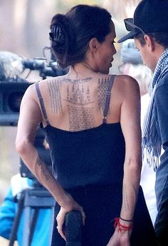 Angelina Jolie was spotted with three new back tattoos while filming her war drama 'First They Killed My Father' in Cambodia on Sunday, Feb. 7