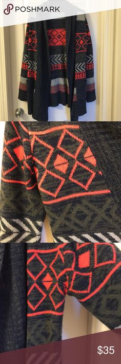 Printed Sweater Cardigan Large Geometrical designed cardigan  Blues/greens/grays and a pink/coral/red?? Not sure how to describe that color.  No holes. No stains Minor piling Sweaters Cardigans