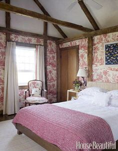 A French-Inspired Bedroom:   This guest room, designed by Tom Scheerer, takes its French Provincial flavor from Quadrille's Lafayette toile de Jouy on the walls. Featured in the April 2009 issue.