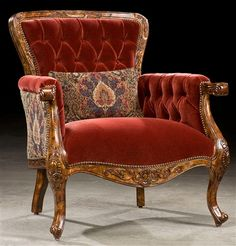 Royal ravishing red accent chair. Bernadette Livingston Furniture has made it easy for anyone to decorate their home with professionally designed unique furniture of the highest quality. All at a great value.