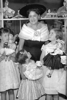 Beatrice Alexander with several girls carrying her dolls at a store promotion in Michigan, Courtesy of Alexander Doll Company, Inc. Forever My Girl, Vintage Madame Alexander Dolls, Alexander The Great, Vintage Dolls, Fashion Dolls, Michigan, Promotion, Archive, Flower Girl Dresses