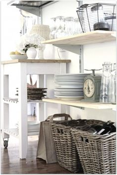 Open shelving to display dishes and kitchen wares is a basic necessity for a beach cottage kitchen. Kitchen Shelves, Kitchen Decor, Kitchen Storage, Pantry Storage, Kitchen Cart, Storage Baskets, Kitchen Organization, Kitchen Design, Kitchen Baskets