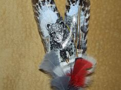 snow leopard painted on feathers