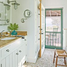 White kitchen with pebbled floor River Rock Floor, River Rocks, River House, River Cottage, Coastal Living, Coastal Decor, Coastal Homes, Coastal Country, Country Charm