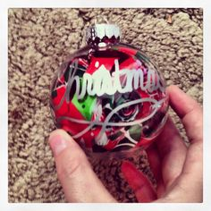 Home made Christmas ornaments!! Now all those scraps of wrapping paper don't have to go to waste!! Just roll them up and toss them in a clear ornament!