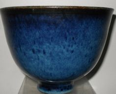 "Mary & Edwin Scheier Mid Century Art Pottery Bowl  Narrow circular footed base ascending to 5 3/4"" diameter opening.  Signed on bottom Scheier.  Blue mottled high glaze."