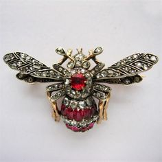 A FRENCH 19TH CENTURY RUBY AND DIAMOND BEE BROOCH