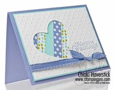 By Chiaki Haverstick. Use scrapbook paper scraps, Spellbinders heart die, Cuttlebug dotted Swiss embossing folder, ribbon, cardstock.
