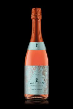Woolton Farm has a beautiful vineyard from which they make highly exclusive and absolutely stunning sparkling rosé wine.We wanted to take everything that was unique about this wine and turn it into an equally high quality, premium label. As a single vin… Wine Bottle Design, Wine Label Design, Wine Bottle Labels, Bourbon, Whisky, Wine Country Gift Baskets, Sparkling Drinks, Champagne Label, Champagne Glasses