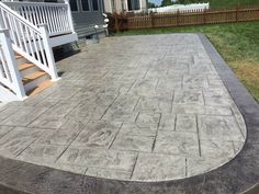 gray concrete patio in backyard