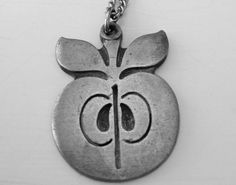 Rune Tennesmed of Sweden Pewter Abstract Mid Century Apple Modern Necklace, $40  https://www.etsy.com/listing/113296791/rune-tennesmed-of-sweden-pewter-abstract