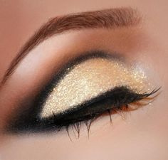 Gold eye Mac makeup. I like it lined in the crease