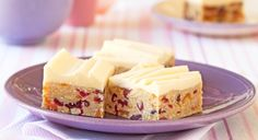 Melt & Mix - Apricot Cranberry Coconut Slice - 250g packet Marie biscuits, crushed 1/2 cup toasted slivered almonds 1 cup sweetened cranberries 1 1/2 cups apricots, finely chopped 1 cup desiccated coconut 395g can sweetened condensed milk 200g butter, chopped Lemon Icing, to serve