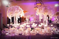 One of the easiest way to add drama to the reception is adding tall floral centerpieces. But remember the bigger you go ...so does the price!
