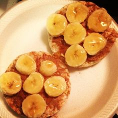 Simple breakfast that will keep you full way into lunch time! 2 low sodium rice cakes, warmed PB2 (or a nut butter), honey, 3/4 banana, and ground cinnamon. Simple and clean. :)