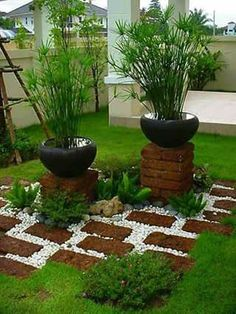 Papyrus Filled Water Pots On Brick Pedestals Excellent Path Idea With White Pebbles And Pavers Way To Make The Expensive Stones Stretch By Adding