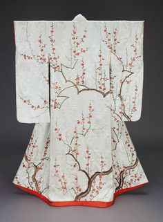 Kimono (furisode) with plum tree branches, made in Japan in the 19th century