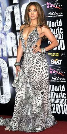 For the World Music Awards in Monte Carlo, Lopez accented a leopard-print Roberto Cavalli gown with a Daniel Swarovski snakeskin clutch and stacks of bangles J Lo Fashion, Fashion Trends, Versace Gown, Fashion Model Poses, Animal Print Fashion, Mode Chic, Leopard Dress, Red Carpet Looks, Jennifer Lopez