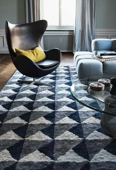 Layered is a Swedish interior fashion brand designing handwoven quality rugs. Picture showing their eye-catching rug Triangle Midnight Blue The beautiful rug is in grey and blue colors. Free worldwide shipping. See more at: http://layeredinterior.com/product/ovals/