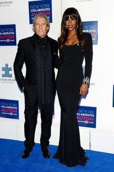 Aren't they lovely? Michael Bolton and Kelly Rowland wow on the blue carpet at the Winter Ball for Autism on Dec. 2 in New York