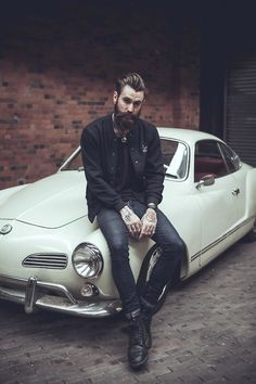 I'm actually looking at the Karmann Ghia in the background #classic
