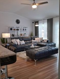 new floor, contemporary furniture and accessories made this living room spacious and comfortable. Great space to relax and entertain.