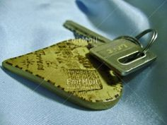 Key and Heart Key Chain t | @FairMail - Fair Trade Cards - Photos - PPTM-0004 | Closeup, Colour image, Heart, Horizontal, Indoor, Key, New home, Peru, Shooting style, South America, Studio