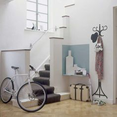 Great space-saving entry way with small footprint staircase.