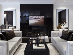 love the look of the tv hidden in minimally reflective black wall and the alternative fireplace