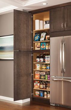 Pantry storage options inspired by Aristokraft cabinets. For more design options call one of our specialists today at 812-537-5111 to schedule an appointment and see what we can do for you! Check out our Facebook page https://www.facebook.com/lawrenceburgwin/ and our website www.lawrenceburgwinsupply.com #proslikeyou #masterbrand #design #homeimprovement #aristokraft #remodel